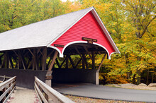 The Flume Gorge Covered Bridge Is Surrounded By Autumn Color In New England