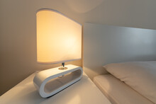 Close Up Of Modern Table Lamp In The Bedroom. Desk Lamp With Bed