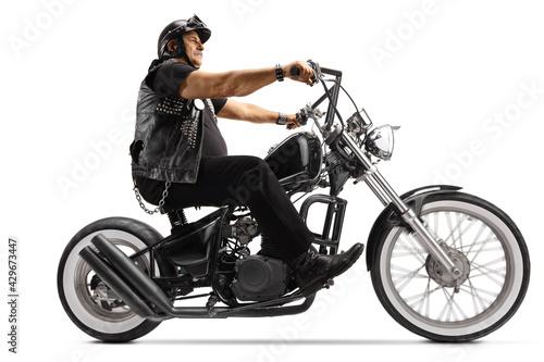 Tablou Canvas Mature biker riding a chopper motorbike