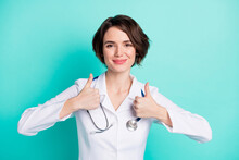 Photo Of Young Woman Happy Positive Smile Doctor Assistant Show Thumb-up Cool Perfect Ad Choice Isolated Over Teal Color Background