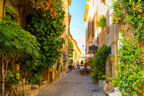 фотография A picturesque back street in the medieval hilltop village of Saint-Paul de Vence in the Provence Cote d'Azur region of Southern France