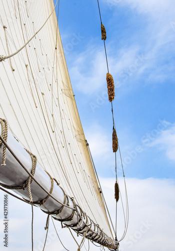 The mainsail and boom of a historic sailing ship.  Copy space. Wallpaper Mural