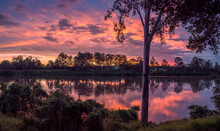 Beautiful Panoramic Riverside Sunset With Reflections