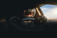 Rally Racer In A Helmet Is Driving A Car Concept.