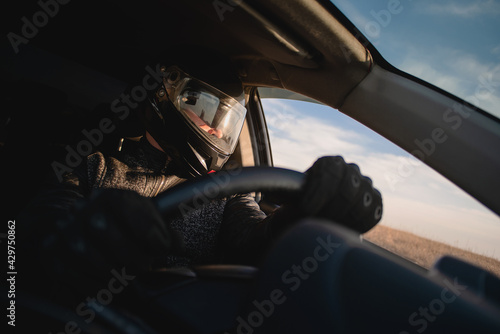 Carta da parati Rally racer in a helmet is driving a car concept.