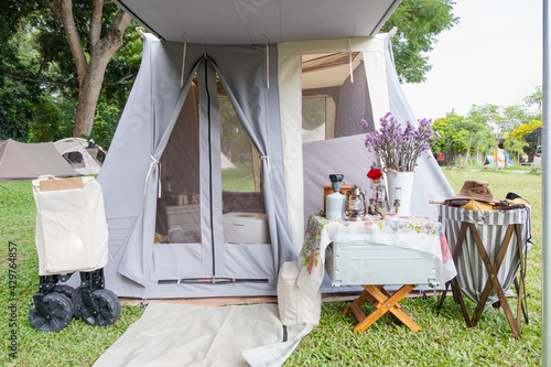 Decoration gray teepee tent with luxurious glamping interior with A lamp and a b Fototapeta