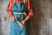 Wooden Retro Reel With Pink Polka Dot Braid In The Female Hands Of A Needlewoman In An Apron.