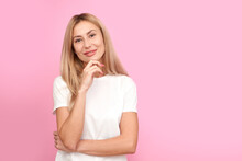 Pensive Young Woman In Doubt Portrait. Thinking Creative Person In White Shirt Holding Chin, Dreamy Girl Thought And Looking At Camera Isolated On Pink Studio Background