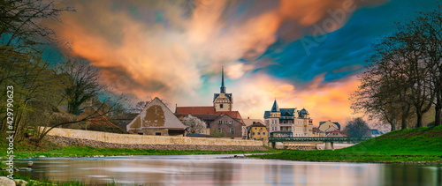 medieval castle by the river in a small European town
