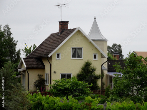 Obraz na plátně A classic villa in the Scandinavian countryside with grass and shrubbery