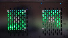 Perforated Bottom Of A PC Case With Two 80mm Green Led  Ventilators.   Fans Cool The PC With Air, And Power Is Supplied By Wires. Backlight Makes The Computer More Beautiful. Video About A Modern  PC.