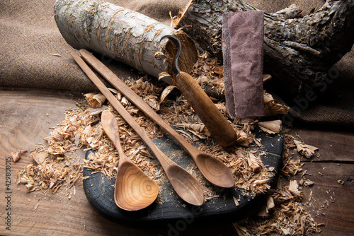 wooden spoon carver at work with hand tools Fototapeta