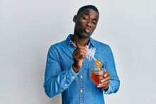 Young African American Man Holding Honey Looking At The Camera Blowing A Kiss Being Lovely And Sexy. Love Expression.