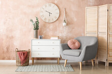 Interior Of Stylish Living Room With Modern Chest Of Drawers