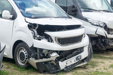 Two Broken Cars White Vans After Frontal Collision.