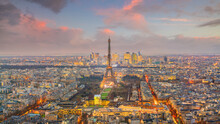 Skyline Of Paris With Eiffel Tower At Sunset In France