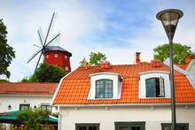Traditional Swedish Houses With Red Tiled Roofs And A Windmill. Strängnäs, Mälaren Lake, Sweden. Travel Destinations, Landmarks, Sightseeing, Cruise, Vacations, Recreation. Panoramic Aerial View