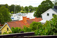 Traditional Swedish Houses With Red Tiled Roofs And A Yacht Marina. Strängnäs, Mälaren Lake, Sweden. Travel Destinations, Cruise, Vacations, Recreation, Estate, Home. Panoramic Aerial View