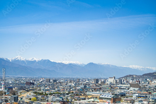 Fototapeta 弘法山から北アルプス方面の松本市