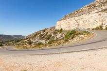 GU-115 Paved Road With A 360 Degree Curve Next To Argecilla, Province Of Guadalajara, Castile-La Mancha, Spain