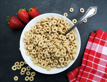 Whole Grain Cereal Rings In A Bowl And Strawberries