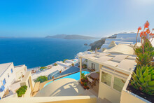 Greece Famous Santorini Island In Cyclades, Panoramic View Of Traditional Whitewashed And Colorful Houses With Caldera Sea In Background