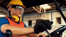 Skillful Worker Drives Forklift In The Factory . Industrial People And Manufacturing Labor Concept .