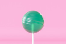 Green Lollipop Sweet Candy On Stick, Pastel Pink Background, 3d Rendering