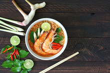 Instant Noodles Tom Yum Kung In A White Bowl On A Dark Brown Wooden Table. Thai Food Style
