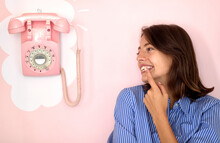 A Beautiful Young Girl Stands Next To A Retro Phone That Hangs On The Wall In The Pastry Shop And Eagerly Awaits The Call. Pastry Shop, Ambience
