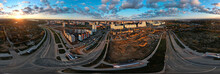 Construction Site At Dawn. Claimed Multi-storey Houses Are Visible. Construction Cranes And Neighboring Urban Quarters. Panoramic Aerial Photography.