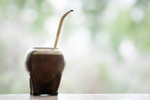 Closeup Of An Argentinian Traditional Wooden Calabash Cup With A Metal Straw