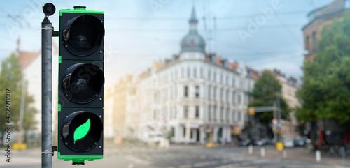 Fototapeta Traffic light with green leaf symbol. Clean mobility concept obraz