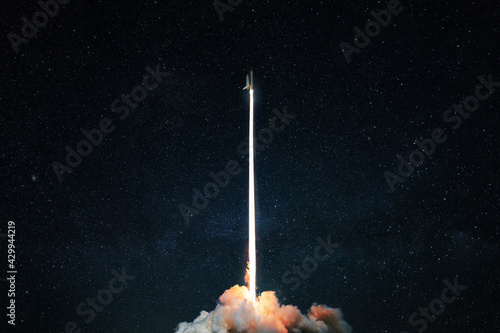 Fototapeta Space rocket launch into the starry sky. Space shuttle with blast and blast lift off into space on a dark background. Successful start, concept obraz