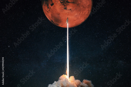 Fototapeta Rocket with blast and smoke takes off to the red planet mars mars, concept