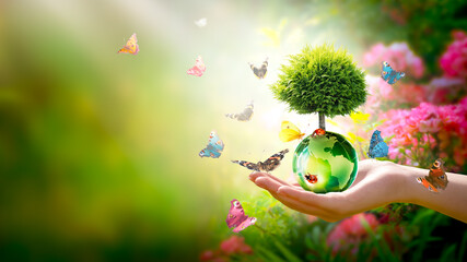 Earth Day or World Environment Day concept. Save our Planet, protect Green Nature and planting trees theme. Growing thuja on globe in hand, ladybugs and flock of many flying colorful butterflies.