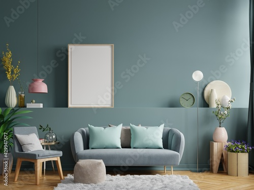 Living room interior wall mockup in bright tones with have sofa and lamp with dark green wall background. - fototapety na wymiar
