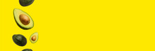 Pitted Avocado And Whole Avocado Fly In The Air On A Yellow Background. Top View, Flat Lay. Banner