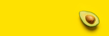 Fresh Ripe Slice, Half An Avocado On A Bright Yellow Background. Top View, Flat Lay. Banner