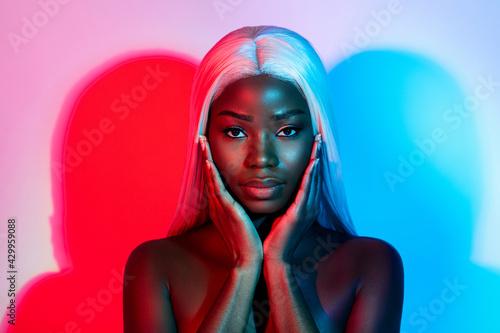 Fototapeta Photo of young beautiful stunning african woman touching cheeks wear artificial