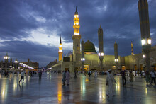 Beautiful Shots Of The Holy Masjid Al Nabawi At Evening Time With White MInarets And The Green Dome