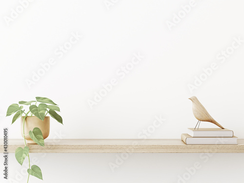 Vászonkép Interior wall mockup in neutral minimalist scandi style with trailing green plant and bird on wooden shaelf on empty white wall background