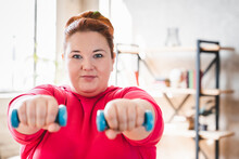 Fat Woman Dieting, Fitness. Big Woman And Sport. Health. Plus Size Young Caucasian Woman Doing Exercise With Dumbbells, Going To Lose Extra Pounds, Strong And Fit, Training Endurance