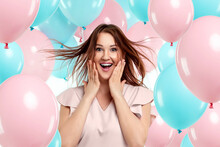 Beautiful Young Girl With With Blue And Pink Balloons On The Background, Joyful Model. Happiness, Spring, Birthday Party.