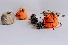 Selective Focus Shot Of Halloween Pumpkin Embroideries, Cones, And A Jute Twine