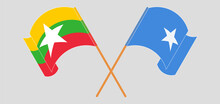 Crossed And Waving Flags Of Myanmar And Somalia