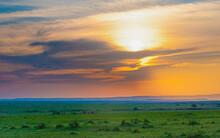Golden Sunrise In The Green Grasslands Of Savannah Masai Mara