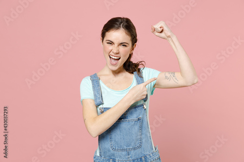 Canvas Print Young strong sporty fitness woman wear trendy stylish denim clothes blue t-shirt