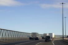 Heavy Trucks & Cars Crossing West Gate Bridge.