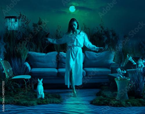 Fotografía Beautiful girl walks on a moonlit path on the water